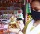 A woman buying a Lord Krishna idol ahead of Janmanstami