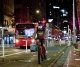 Auckland: Man wearing a face mask rides a bicycle