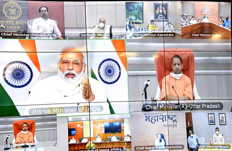 Prime Minister Narendra Modi interacing with Uttar Pradesh Chief Minister Yogi Aditiyanath