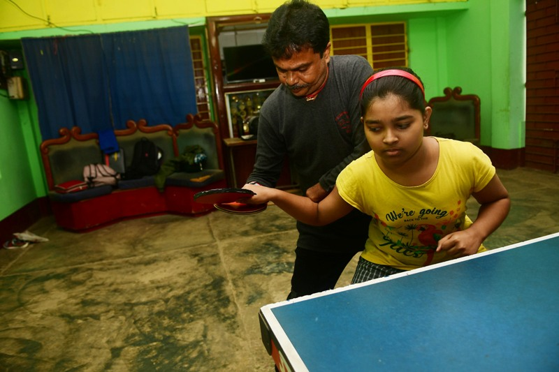 Disabled table tennis player Kajol Dey with his students on International Day of Persons with Disabilities in Agartala