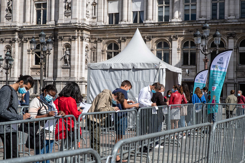 Paris: People queue up at a temporary screening center for COVID-19 PCR tests