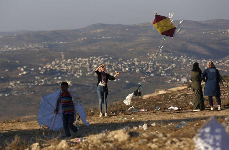 People flying kites on Eid in West Bank city of Nablus