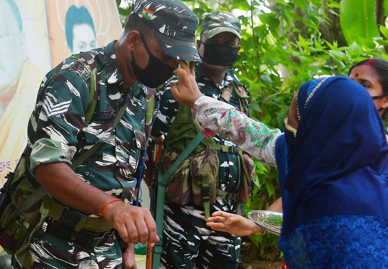 Muslim girls tying Rakhi