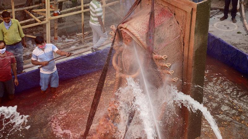 Unique Durga idol immersion in Kolkata by Tridhara Sammilani