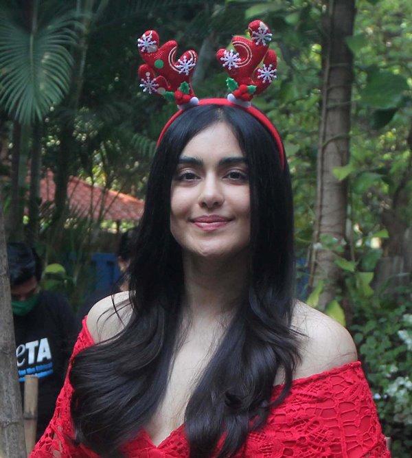Adah Sharma dresses as Santa Claus