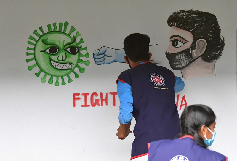 Students create awareness on COVID19 by painting on school wall