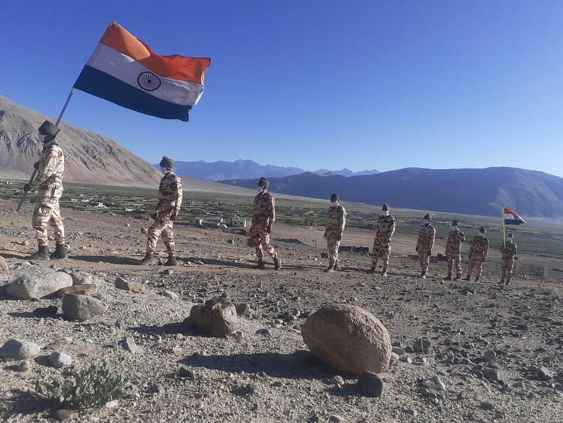 Indian border guards walk with the tricolour in Ladakh near Chinese border on I-Day
