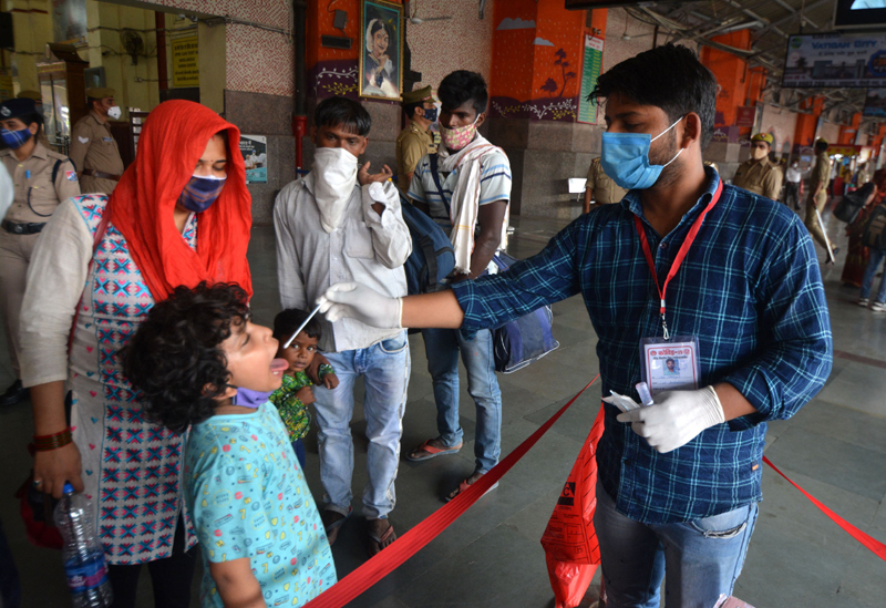 Lucknow: A medico collecting swab sample for Covid 19 test