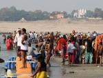 Devotees take holy dip in Ganga during anti-Covid lockdown in Prayagraj