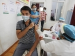 Youth receives COVID-19 vaccine