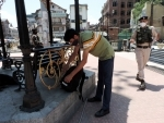 """Kashmir: Security personnel opening an unclaimed bag at """"Time Pass"""" park"""
