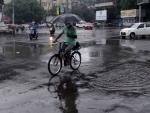 Glimpses of rain splashed Kolkata roads