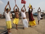 Devotees performing Yoga on the occasion of International Yoga Day