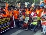 BJP workers in a 'Wheelchair Tribute March' attacking West Bengal CM Mamata Banerjee