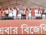 Amit Shah waves at the crowd in election rally in West Bengal