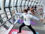 Japan: People practicing Yoga on the top floor of Tobu Tower