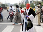 Man in spiderman attire requests motorists to obey Covid protocol in Hyderabad