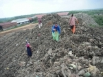 Agartala: Ragpickers collect recyclable materials from garbage dump