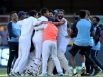Indian players celebrate Brisbane victory