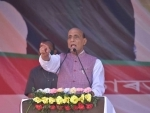 Rajnath Singh addressing an election campaign rally ahead of the Assam assembly polls