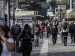 Glimpse of people walking on a street of Sao Paulo in Brazil amid the COVID-19 outbreak