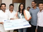 Andhra CM Y S Jagan Mohan Reddy presenting Rs.5 lakh cheque to P V Sindhu