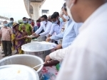 People waiting in queue for food in Agartala