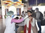 Health workers collect Covid-19 test swabs of Maharashtra returnees at Patna station