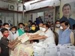 Congress state president Madan Mohan Jha distribute COVID-19 relief kits in Patna