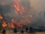 Firefighters battle a blaze in Vilia