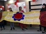 Students showing 16 feet long and 3.5 meter broad Rakhi