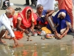 Hindu devotees perform ritual in Prayagraj