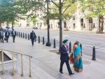 Nirmala Sitharaman with ambassador Taranjit Singh Sandhu walking through the streets of Washington DC