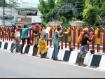 Labourer painting divider on a road as Lucknow preps up for Prez's arrival