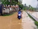 Vehicles passing through waterlogged roads as heavy rains lash Kerala