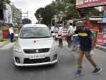 Volunteer sprays disinfectant on vehicles in Patna