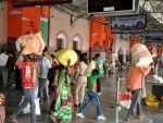 Passengers arrive at Lucknow's Charbagh Railway Station amid Covid lockdown