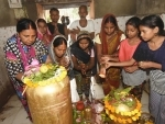 Hindu devotees offering Jalavishek to Lord Shiva