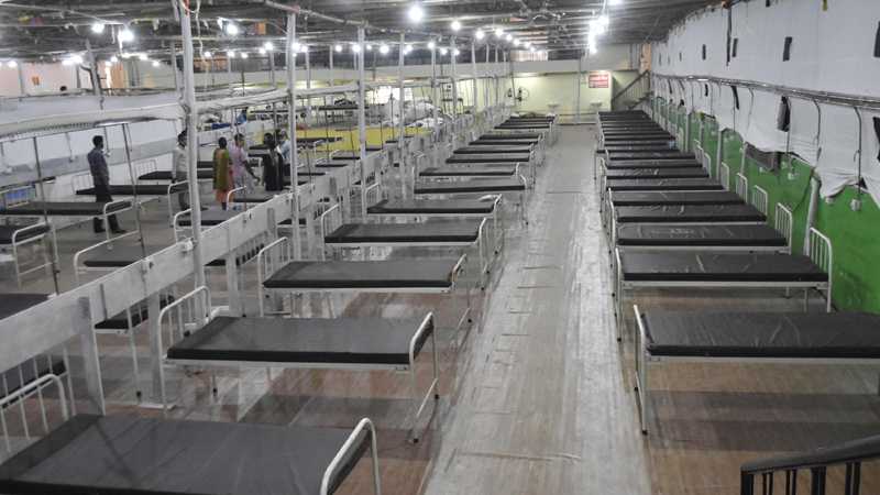 COVID-19: Worker prepares beds at Patliputra Sport Complex