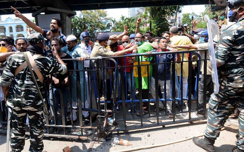 TMC activists gather outside CBI office at Nizam Palace in protest against politicians' arrests