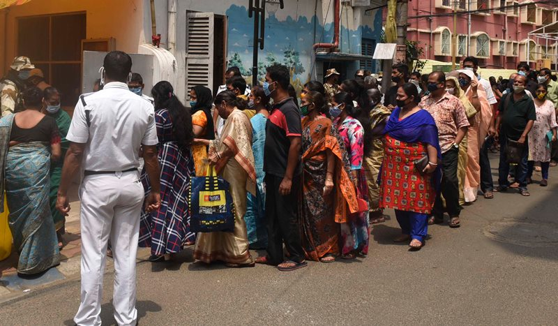 Voters waiting in queue at Thakurpukur polling station in Kolkata during Bengal Assembly Elections