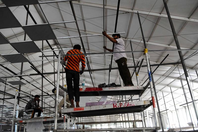 New Delhi: Workers constructing temporary COVID-19 care centre