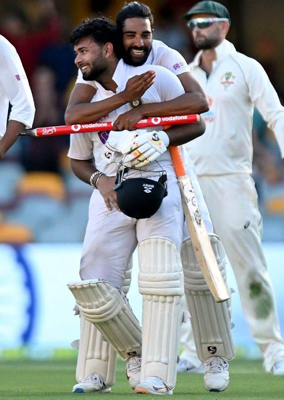 Indian players celebrate Brisbane victory