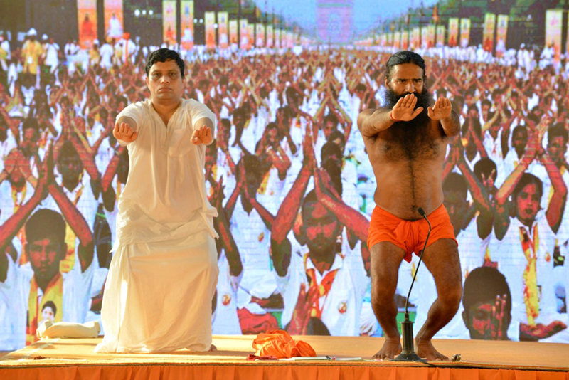 Swami Ramdev, Achariya Balakrishna perform Yoga with followers at Haridwar