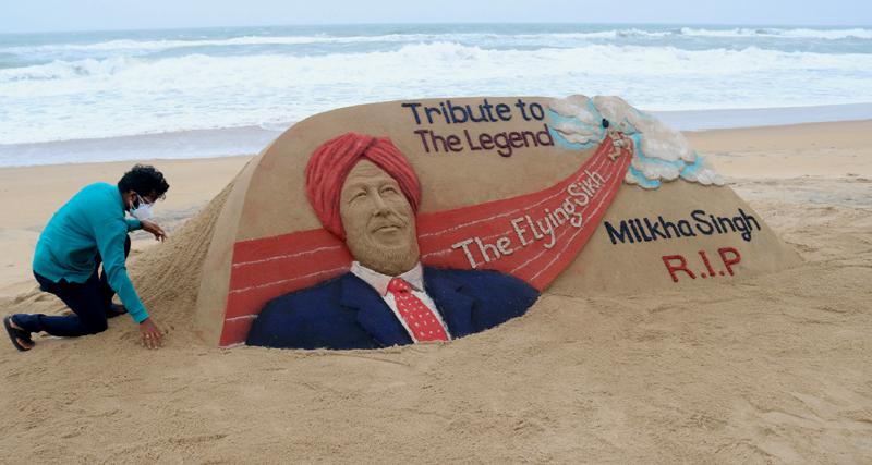 Milkha Singh: Sudarshan Pattnaik creates sand art in his memory