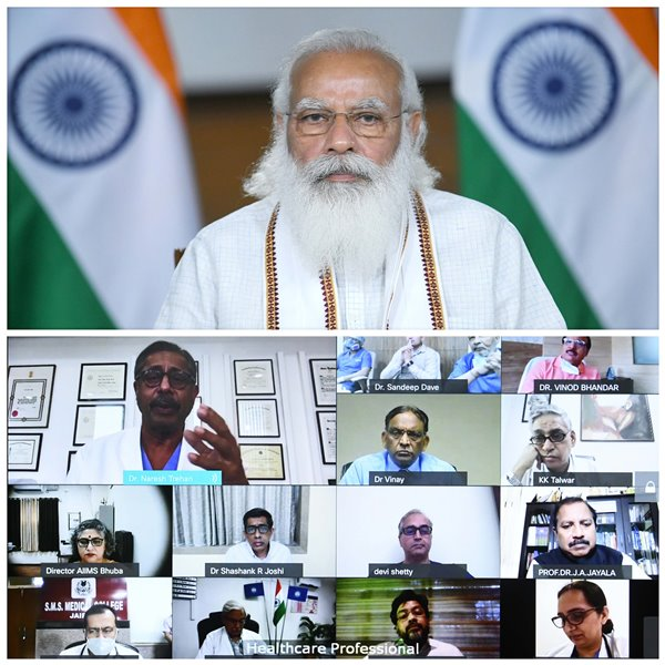 PM Modi interacts with healthcare professionals through video conferencing in Delhi