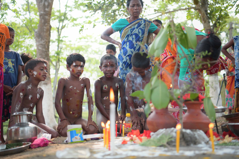 Workers of Durgabari Tea Garden in Agartala hold a pair of frogs in prayers for rain