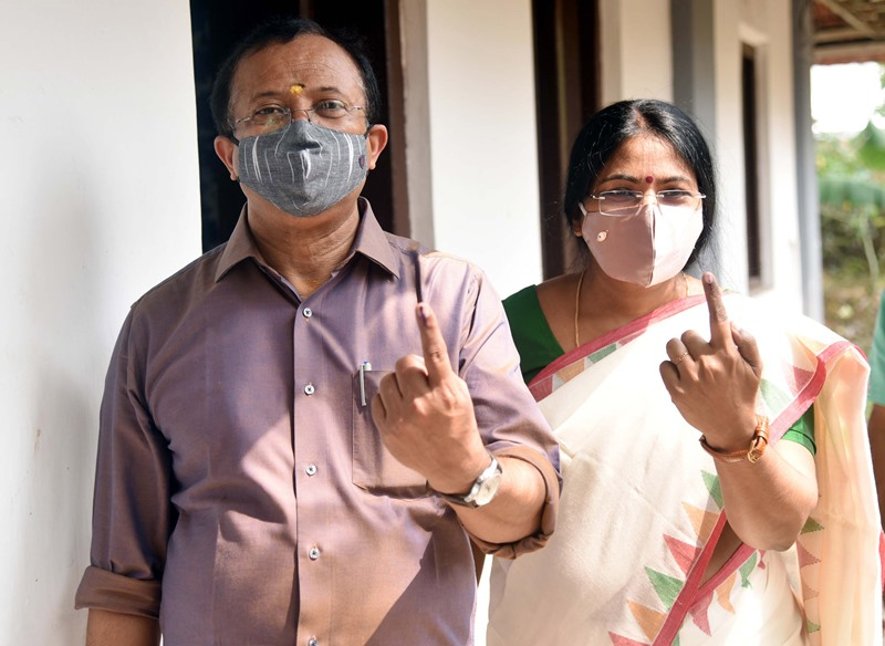 Union Minister V Muraleedharan and his wife cast votes in Kerala polls