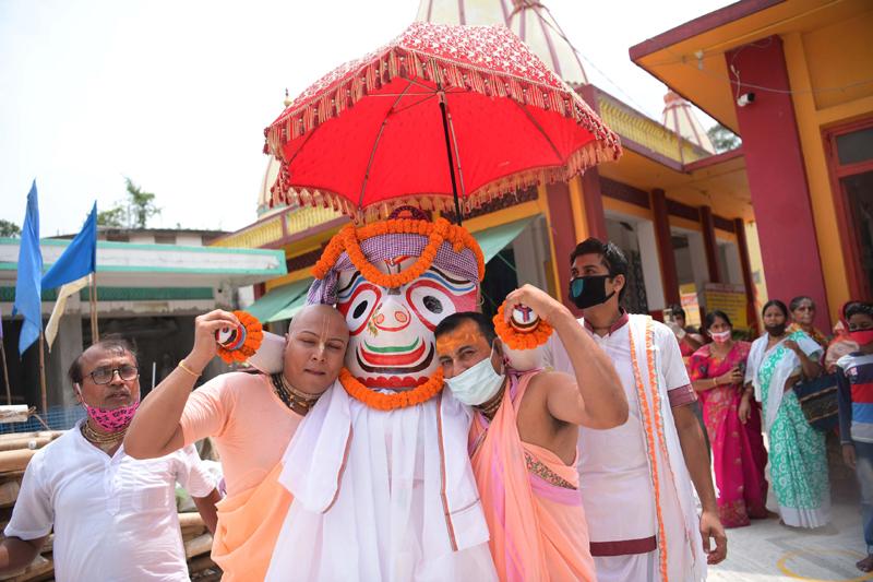 Hindu priests performing rituals during the Snana Yatra of of Lord Jagannath,Subhadra and Balabhadra
