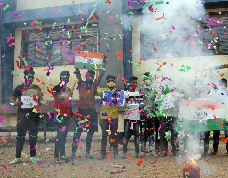 People in India celebrate India's historic win in Australia